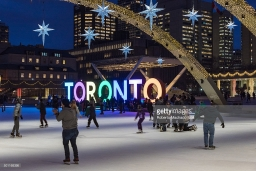 NATHAN PHILLIPS SQUARE, TORONTO, ONTARIO, CANADA - 2015/12/09: Nathan Phillips Square and the Toronto Sign at night. Toronto inhabitants and visitors can enjoy a free skating rink in the square which is a major tourist landmark in the city. (Photo by Roberto Machado Noa/LightRocket via Getty Images)